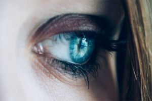 close up of woman's eye looking in the distance