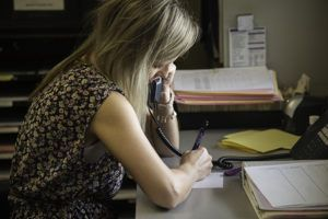 woman on phone receiving a crisis call on the hotline