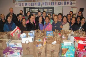 employees from Molly Maids of Tinley Park pictured with baby items they donated for CCSS clients